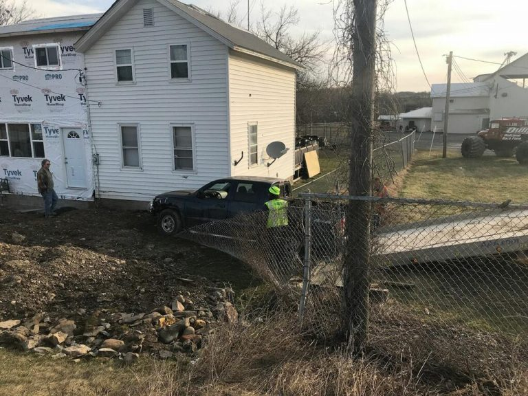 Pickup truck crashes near home on Main St. in Dundee